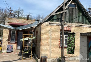 Продам дом в  Жулянах, ул.Комсомольская.